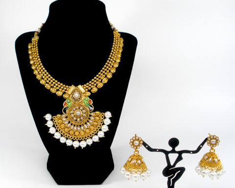 statement peacock necklace set in broad gold chain