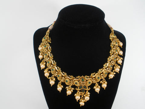 Antique gold finish necklace set with peacock and pearls