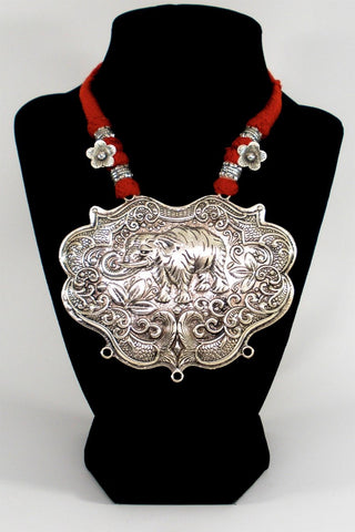 grand oxidized pendant in red ethnic thread