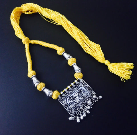 ethnic oxidized pendant in ethnic thread