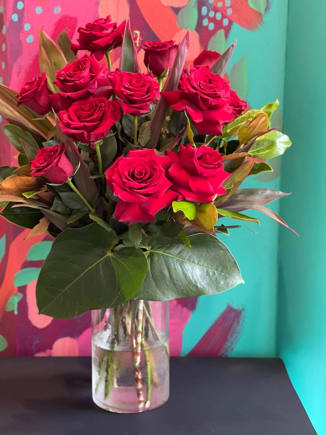 VALENTINES DAY ONE DOZEN RED ROSES IN CLEAR GLASS VASE