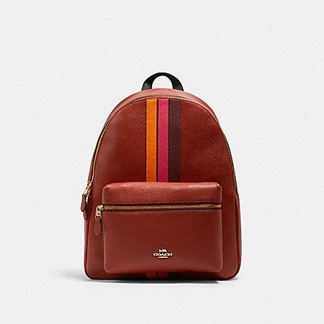 Coach Charlie Large Backpack With Varsity Stripe In Terracotta Electric Pink