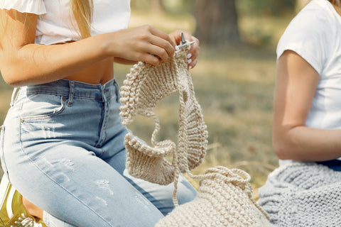 The Best Yarns for Knitting, Weaving, Crochet, and More - Girl sitting knitting in Commox BC
