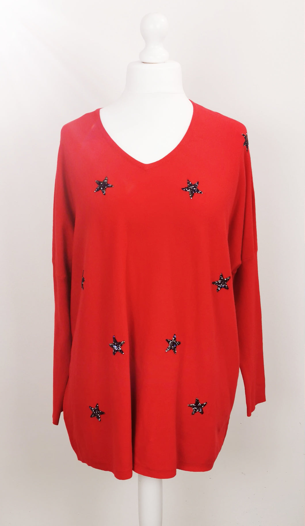 Oversized glitter star jumper