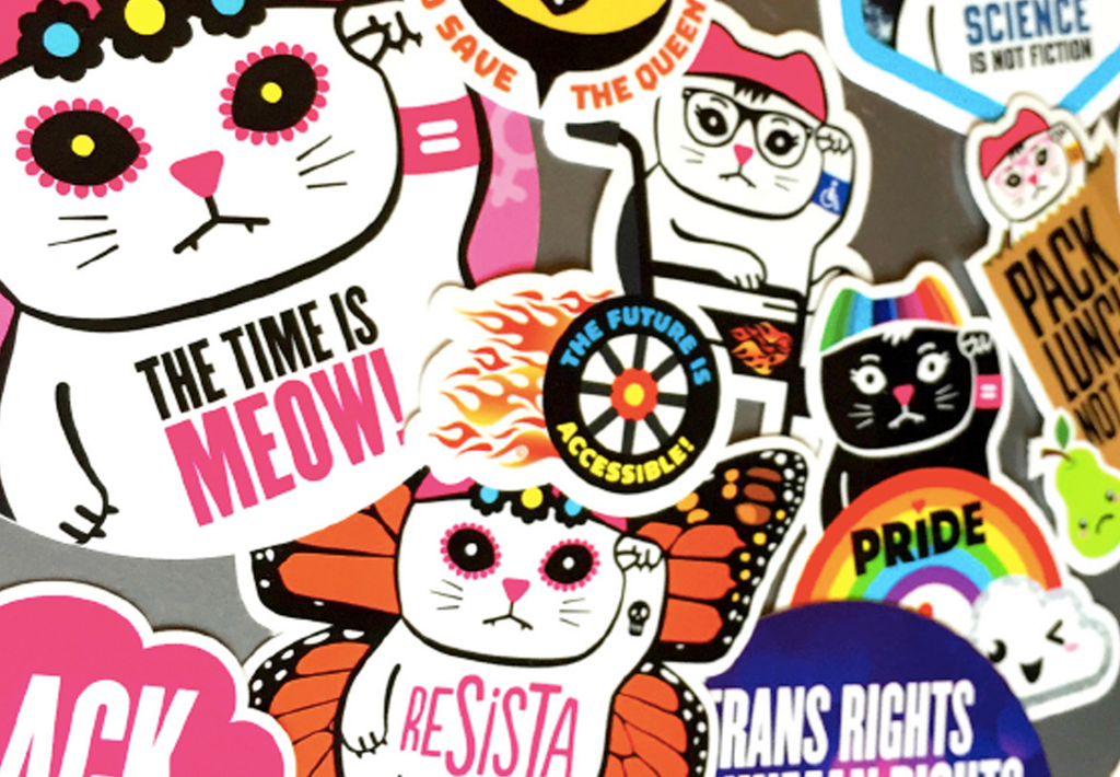 Meet ReSISTA Kat, an activist fundraising organization in Portland, OR, creating feminist apparel and political cat gifts.
