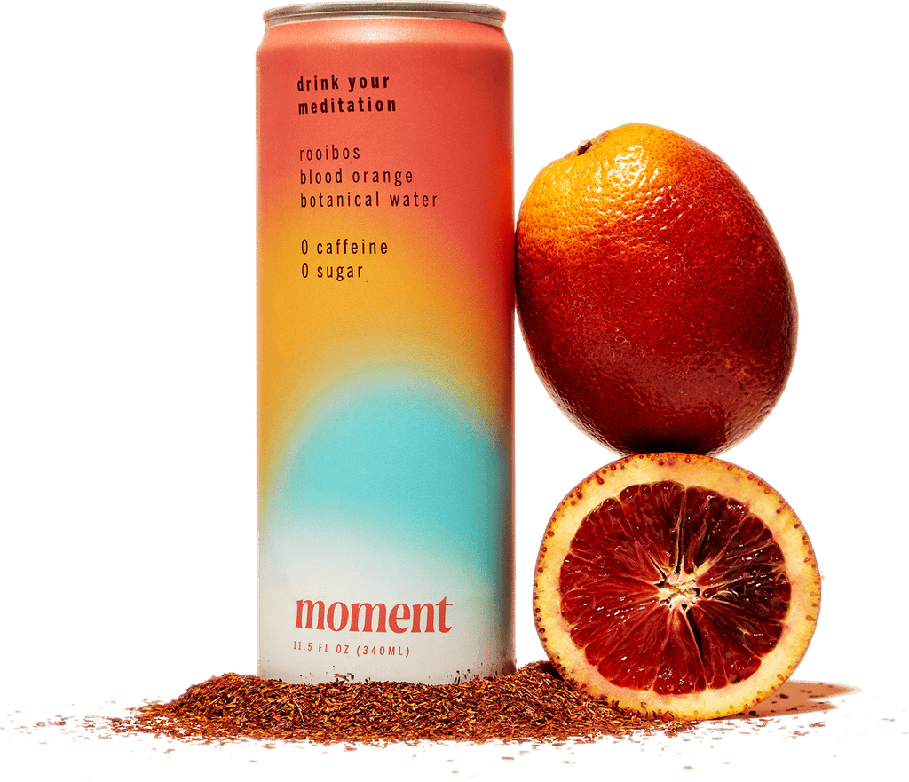moment drink can with fresh oranges