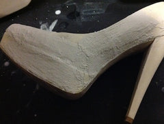 mosaic shoe being plaster clothed