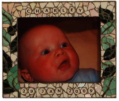 mosaic photo frame using glass gems to make words