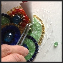 Layering glass pieces to the mosaic