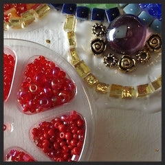 Adding glass seed beads to the mosaic