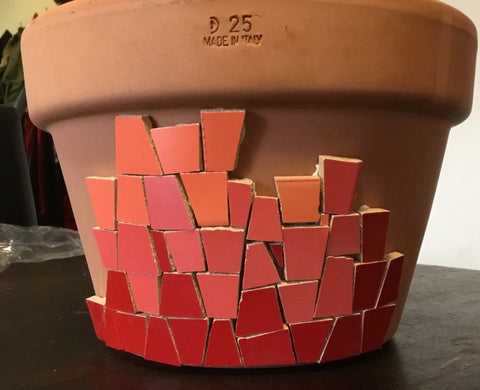 A ceramic mosaic garden pot work in progress. Using irregular ceramic tiles to create a colourful and easy to make mosaic project.