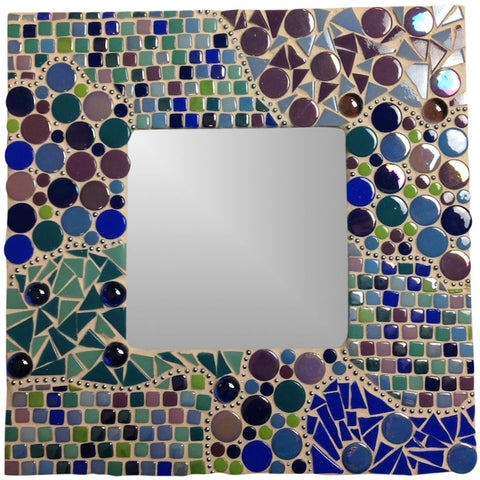 Mosaic mirror craft project made with recycled glass mosaic tiles