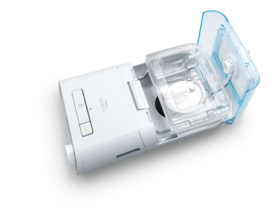 CPAP device with humidifier attached and open