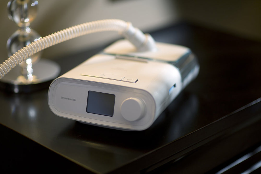 CPAP device sitting on nightstand