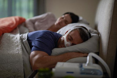 Man sleeping on his stomach wearing nasal mask