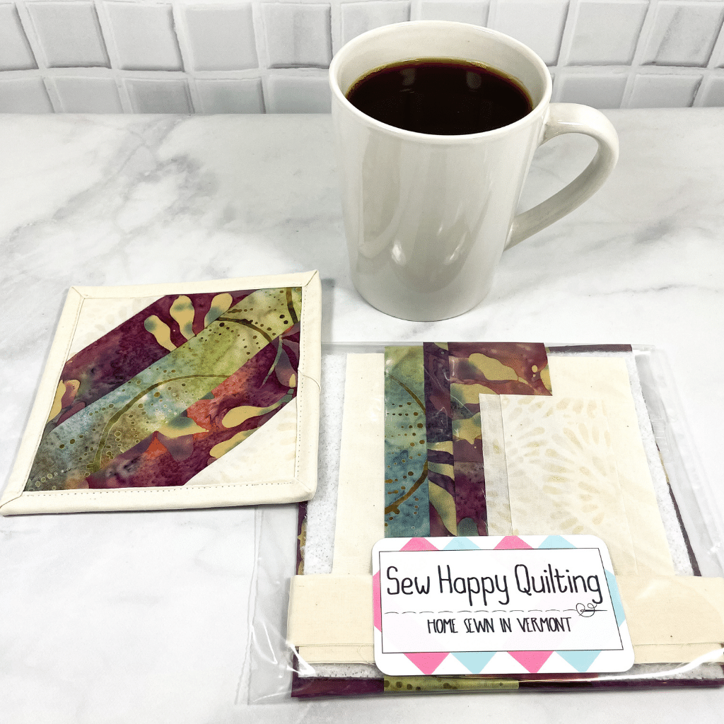 This is a mug rug quilting craft kit that includes all the batik fabric and printed directions you need to make one drink coaster.  It's a project you will get to admire on your coffee table, desk or home coffee bar.  It makes a great weekend DIY project for crafty adults.  Click to find out more about this quilt kit.
