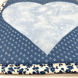 These are gorgeous blue and white quilted potholders with an applique heart in the center.  The trivets are a great addition to your kitchen and are made from 100% cotton fabric and washable too.  Practical yet beautiful when used as hot pads on your kitchen island or dining table.