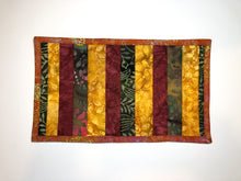 Load image into Gallery viewer, Orange and Burgundy Batik Fabric Cat Food Mat
