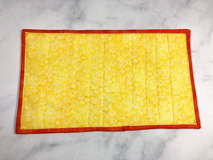 Yellow and Orange Cat Food Mat