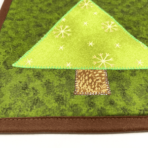 These are gorgeous Christmas tree themed quilted potholders for your home.  The trivets are made from 100% cotton fabric and are washable.  Practical, yet beautiful when used as hot pads on your kitchen island or dining table.