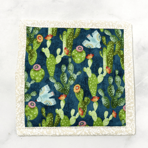 Mug rugs are also known as drink coasters. They are made from 100% cotton fabric, are insulated and washable too. These are great accessories for your home office desk or for your coffee bar area. This particular one is made with a gorgeous blue and green cactus print fabric.