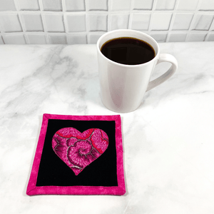 This is a heart themed fabric drink coaster aka mug rug that is made from a gorgeous Kaffe Fassett fabric in the center.  These make great gifts for the one you love.  Washable, insulated and made from 100% cotton.