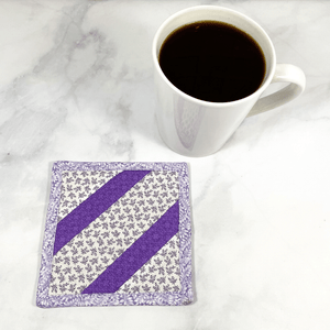 Mug rugs are also known as drink coasters.  They are made from 100% cotton fabric, are insulated and washable too.  These are great accessories for your home office desk or for your coffee bar area, adding a splash of color and uniqueness.