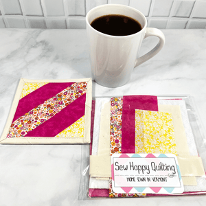 This is a mug rug quilting craft kit that includes all the fabric and printed directions you need to make one drink coaster.  It's a project you will get to admire on your coffee table, desk or home coffee bar.  It makes a great weekend DIY project for crafty adults.  Click to find out more about this quilt kit.
