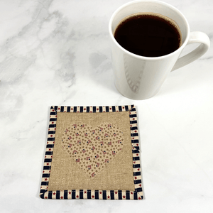 Mug rugs are also known as drink coasters.  They are made from 100% cotton fabric, are insulated and washable too.  These are great accessories for your home office desk or for your coffee bar area.  This particular one has an Americana theme with a heart applique made from small flag fabric.