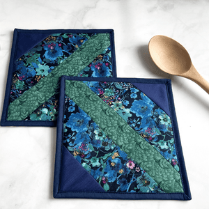 Check out this set of two handmade pot holders that have a wonderful cottagecore vibe.  The gorgeous fabrics are 100% cotton.  These trivets are great for hot dishes and will protect your kitchen island and dining room table.  These are a one of a kind item that makes great gifts for that baker or cook in your life.