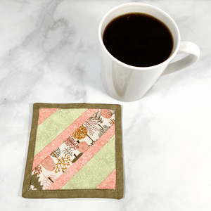 This fun tree themed mug rug is made with strips of fabrics in shades of light pink and mint green.  These mug rugs make great gifts for your coworker or your friend who has everything.   They are insulated, washable and made from 100% cotton.