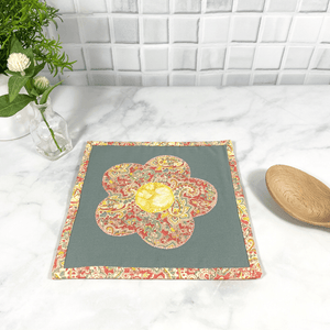 These are gorgeous gray, pink and yellow flower themed quilted potholders for your home.  The trivets are made from 100% cotton fabric and are washable.  Practical, yet beautiful when used as hot pads on your kitchen island or dining table.