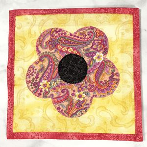 These are gorgeous pink and yellow flower quilted potholders for your home.  The trivets are made from 100% cotton fabric and are washable.  Practical, yet beautiful when used as hot pads on your kitchen island or dining table.