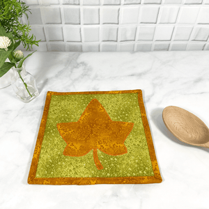 These are gorgeous orange and green maple leaf quilted potholders for your home.  The trivets are made from 100% cotton fabric and are washable.  Practical, yet beautiful when used as hot pads on your kitchen island or dining table.