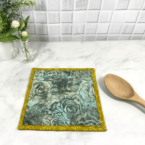 These are gorgeous blue and yellow batik fabric quilted potholders for your home.  The trivets are made from 100% cotton fabric and are washable.  Practical, yet beautiful when used as hot pads on your kitchen island or dining table.