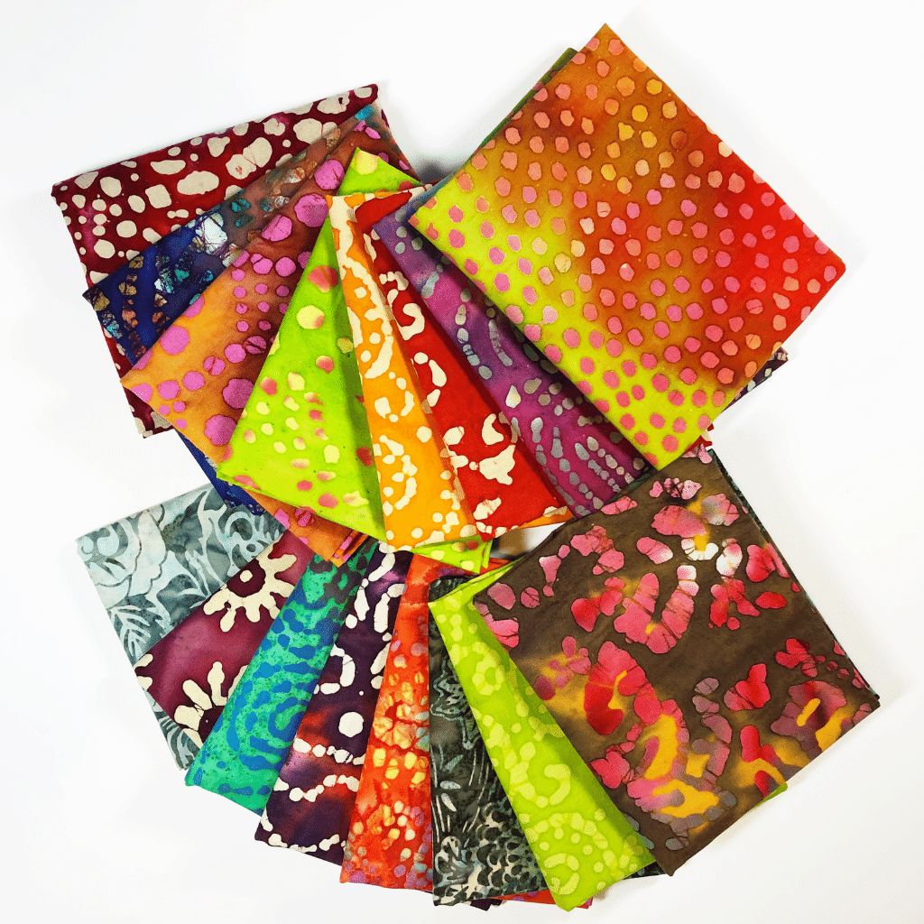 This monthly fat quarter subscription box comes with 7 fat quarters of 100% cotton batik.  You will get a nice variety each month all tied with a bow and delivered right to your door.  These make great gifts for the quilter in your life so they can build their fabric stash.