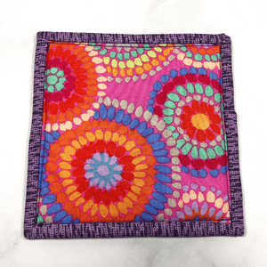 Mug rugs are also known as drink coasters.  They are made from 100% cotton fabric, are insulated and washable too.  These are great accessories for your home office desk or for your coffee bar area, adding a splash of color and uniqueness.  These are made with pink and purple fabric as well as fabric by Kaffe Fassett for the heart and the backing fabric.
