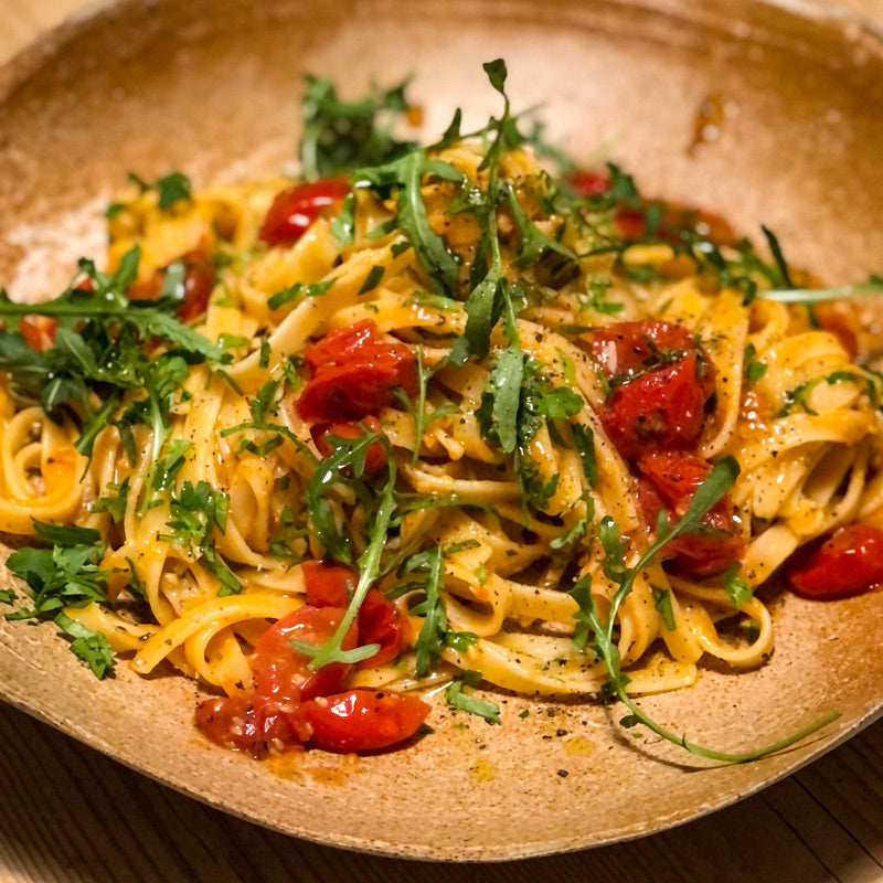 Seafood Fettuccine with Garlic Roasted Tomatoes and Rocket