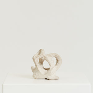 Off-white abstract knotted sculpture