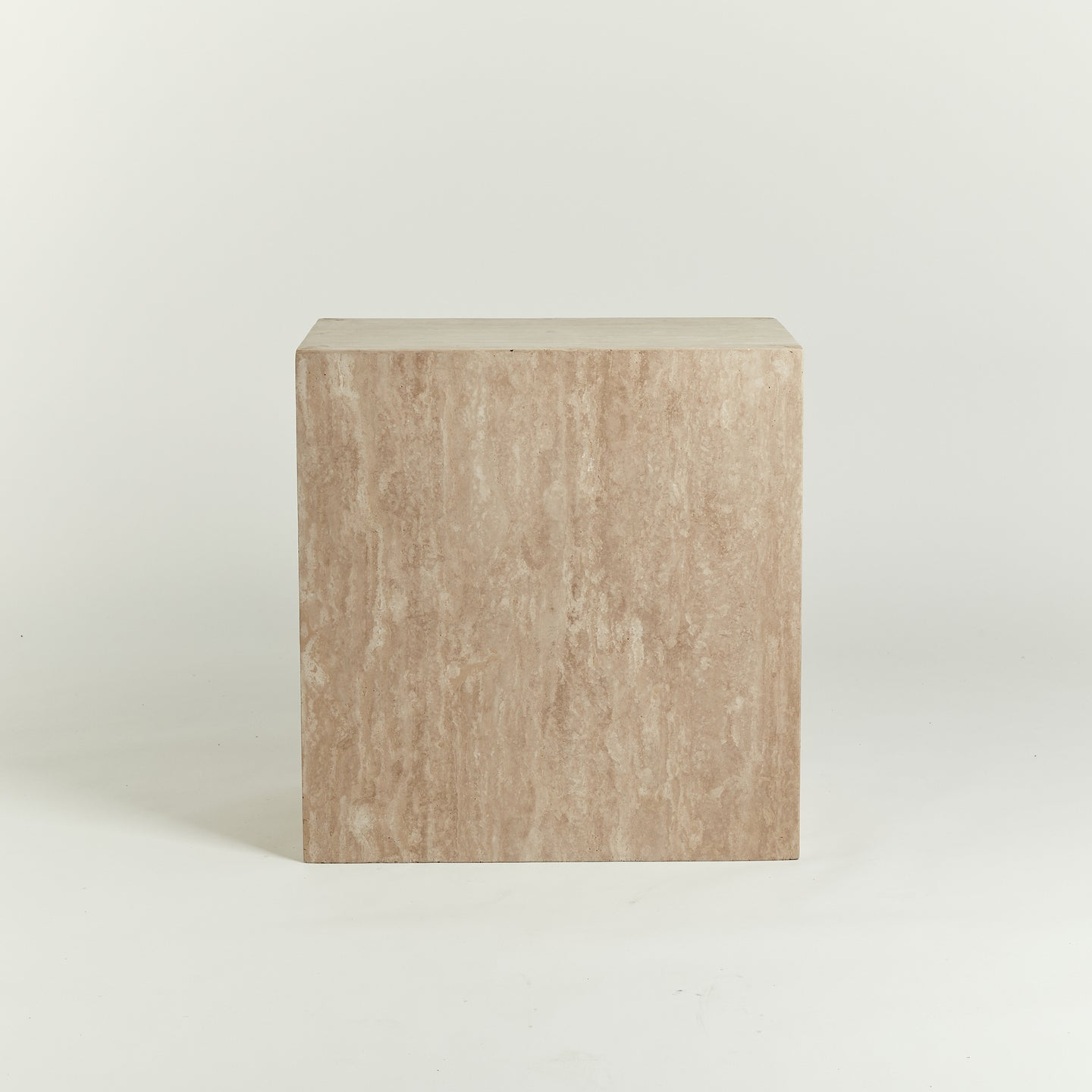 Monolithic travertine side table