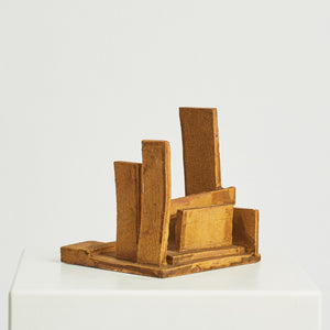 Abstract square pottery sculpture in golden yellow