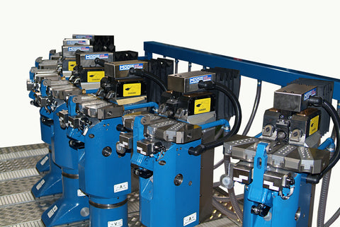 36 axischordfixtureby MODIG auto positions to suit components increasing cutting speed