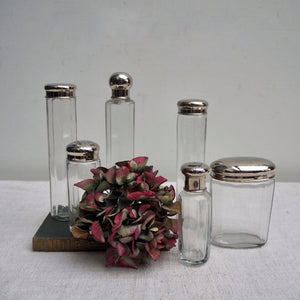 Oval Vintage Glass Bottle with Solid Lid