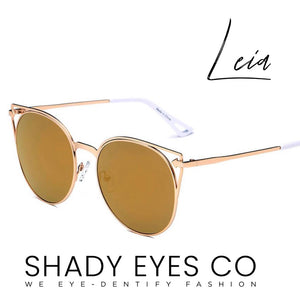 Round Cat Eye Sunglasses-  Classy Cat-eye design with vintage round lenses enlivened with a subtle cut-out effect. Made with scratch-resistant UV-protected mirrored lenses and a metal frame.