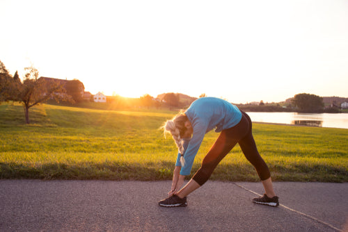 Image of woman stretching outside