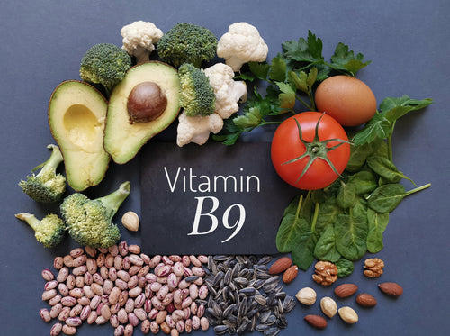 Image of paper that says vitamin b9 surrounded by foods with B1