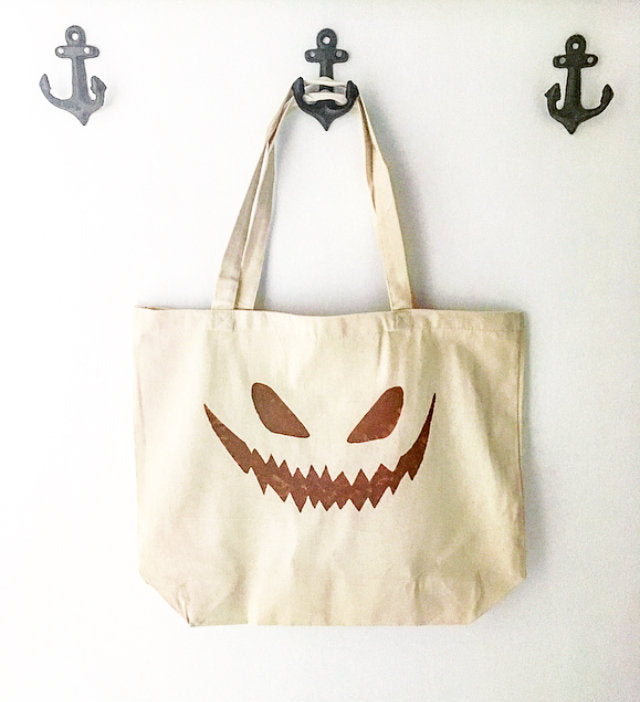 Jack-o-lantern face over sized canvas tote