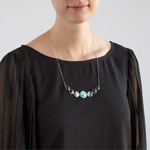 silver moon phases necklace on black blouse
