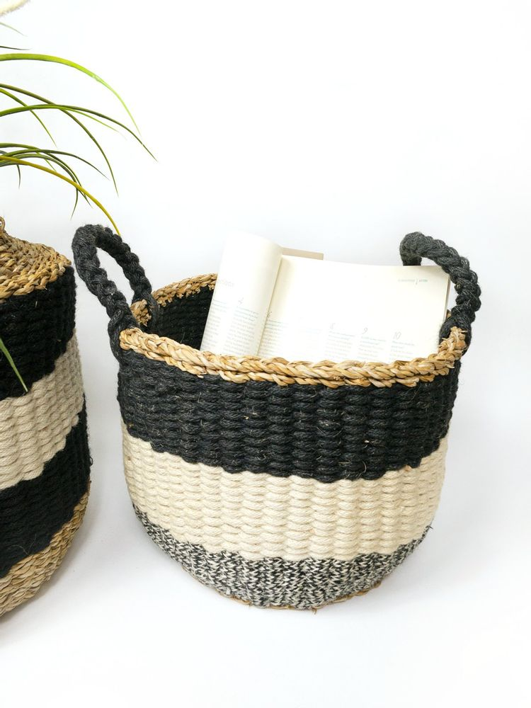 black gray and white stripped basket with handles