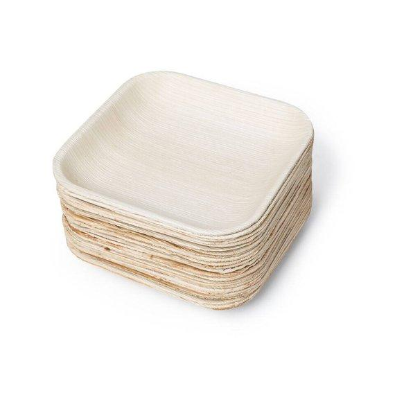 stacked sqaure palm leaf plates